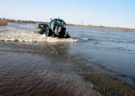 половодье, затопление, трактор, река|Фото: 45.mchs.gov.ru
