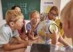 учитель с учениками (2019) | Фото: Fotolia / Gpointstudio / РИА Новости