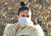 Девушка в медицинской маске  (2020) | Фото: Накануне.RU