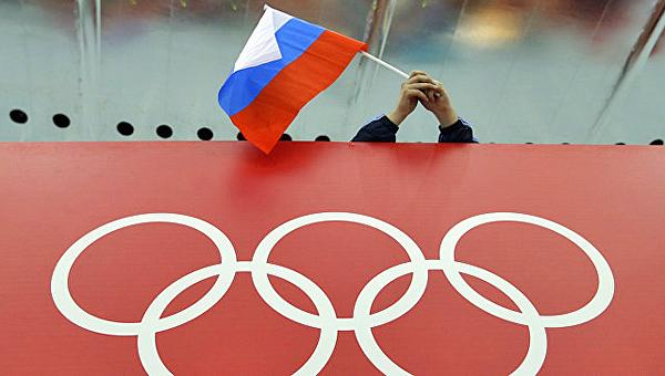 Россия, Олимпиада, Олимпийские кольца, флаг Фото: AP Photo / David J. Phillip